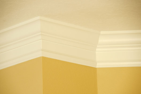 yellow room with white crown molding