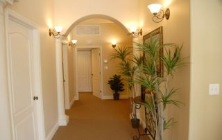 pale yellow hallway with white doors