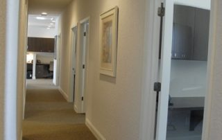white hallway with glass doors